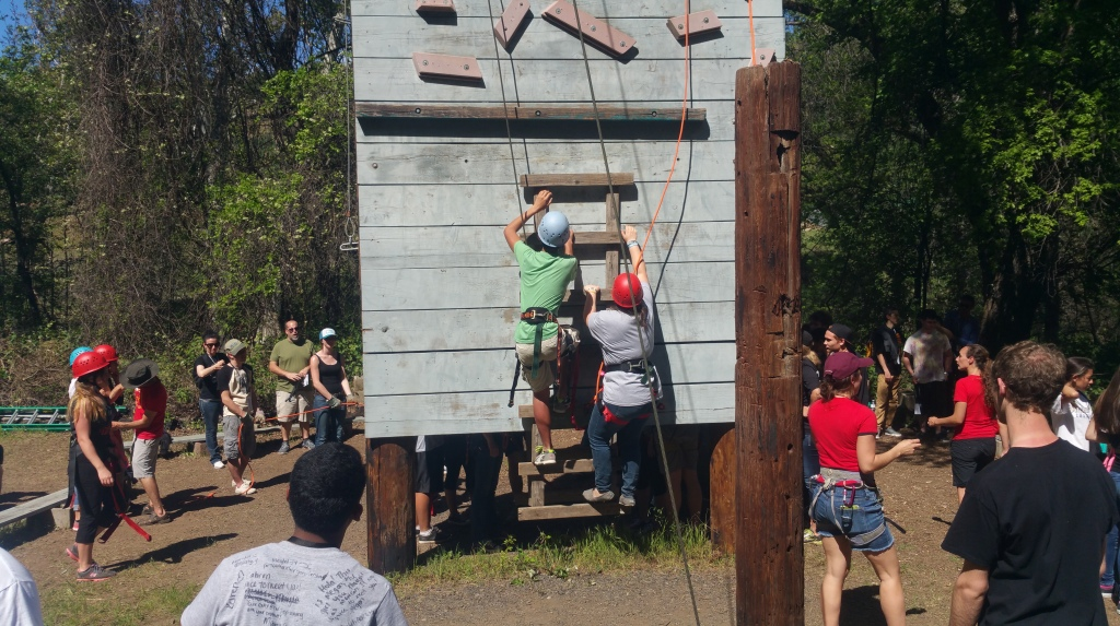 Participants start climbing the wall with the goal of ringing the bell at the top.